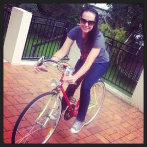 Caro sitting on Pub Bike